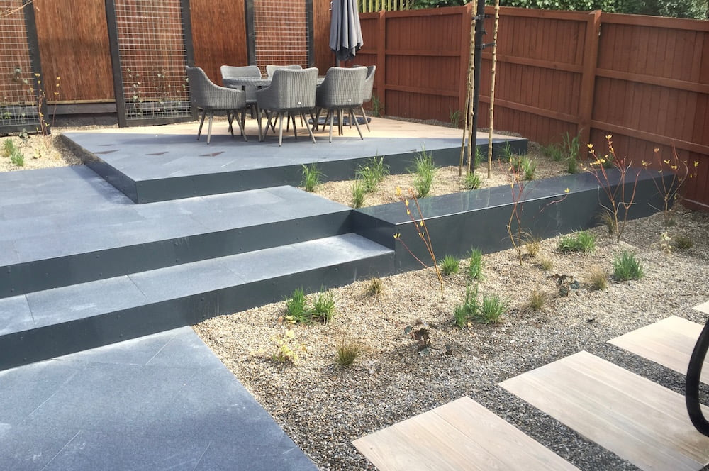 Contemporary landscaped garden Wigan by Warnes McGarr & Co